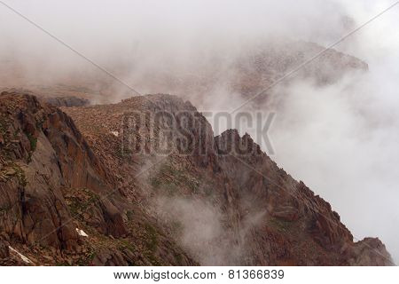 Mountaintop in fog