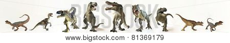 A Group Of Nine Dinosaurs In A Row