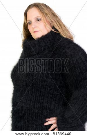Woman in a black angora sweater