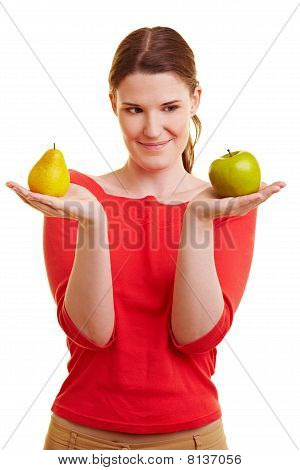 Woman Holding Apple And Pear