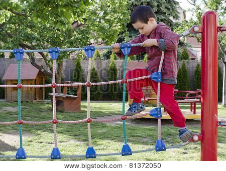 Child Playing At Playground