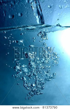 bubbles and drops of blue water jet