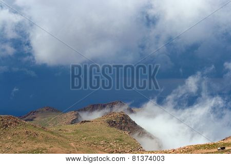 Mountaintop in clouds