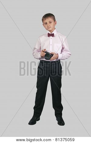 Growth Portrait Of A Boy With A Camera On A Gray Background