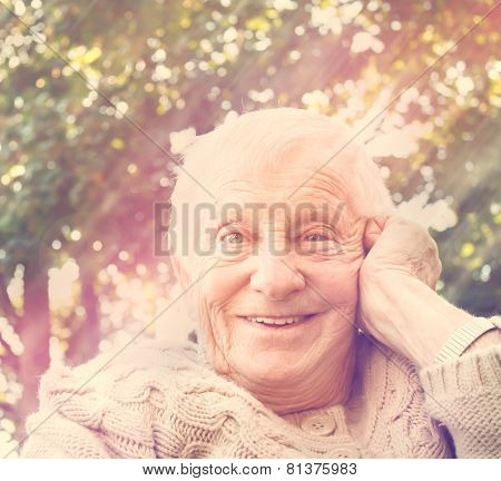 Senior Woman Smiling Outside