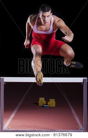 Athlete On Hurdle In Track And Field