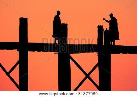Monks on the wooden bridge