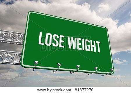 The word lose weight and green billboard sign against sky