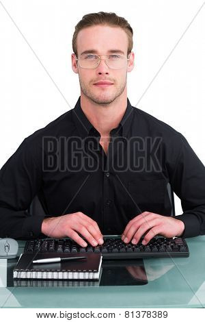 Serious businessman working at his desk on whit ebackground