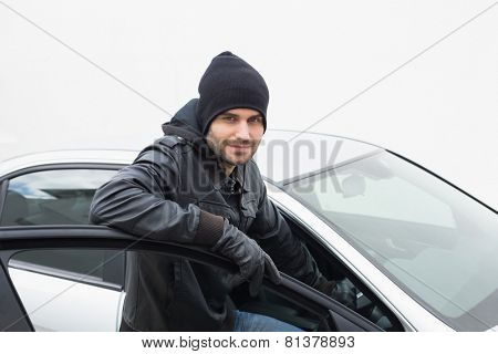 Car thief looking at camera in broad daylight