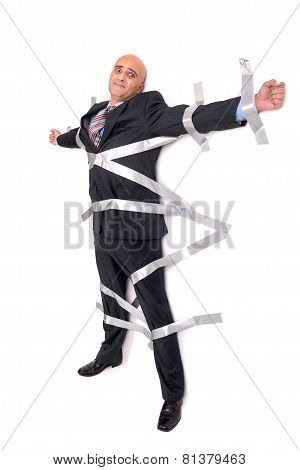 Businessman Glued To The Wall
