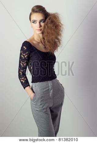 beautiful girl in pants and a black t-shirt in the style of the business in the Studio