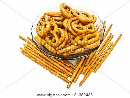 Salted Pretzels And Breadsticks On White