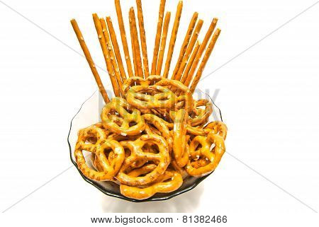 Some Tasty Pretzels And Breadsticks On A Plate