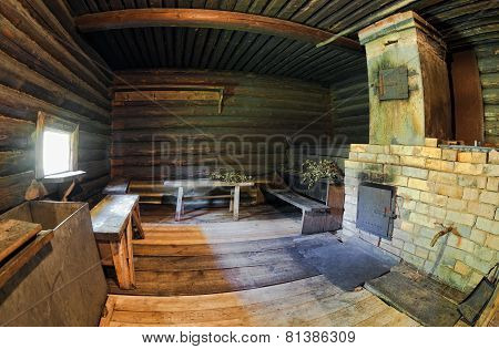 Interior Of Traditional Russian Wooden Bath With Brick Oven