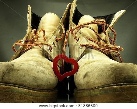 Pair Of Heavy Military Boots And Red Heart.