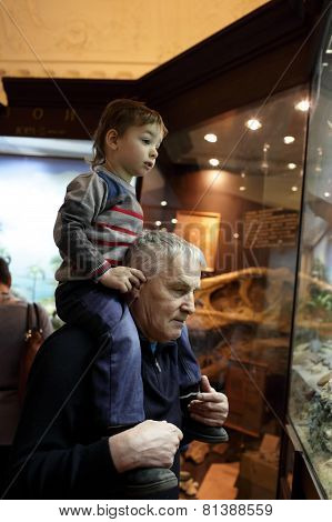 Grandfather With His Grandson Visiting Museum