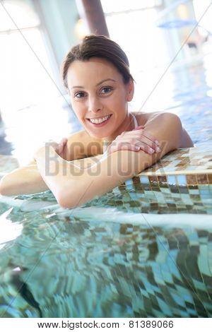 Woman relaxing in seawater spa pool