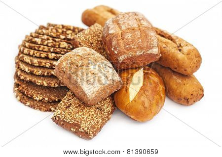Slices of wholewheat bread and diversity of biscuits isolated on white background