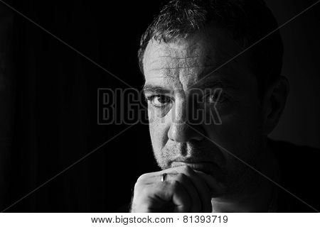 Black and white portrait of a sad man