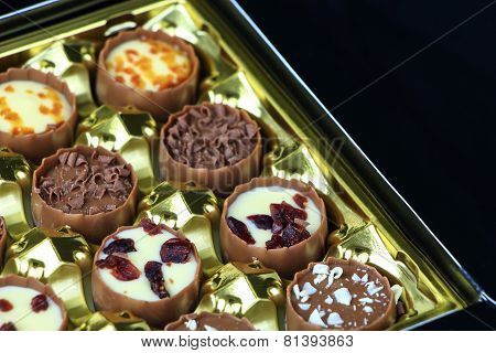 Assorted Chocolate Confectionery On Black Background And Copy-space