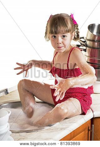 Cute girl washing the dishes