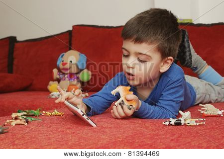Boy playing on tablet, indoor