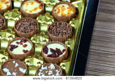 Assorted Chocolate Confectionery Gift Box On Wood