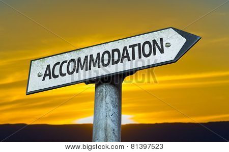 Accommodation sign with a sunset background