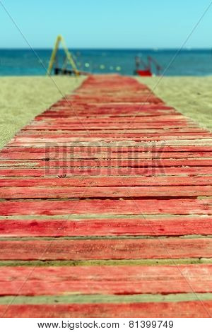 Red Wooden Path To The Sea