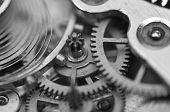 foto of cogwheel  - Black and white background with metal cogwheels inside clockwork - JPG
