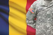 stock photo of chad  - American soldier with flag on background  - JPG