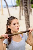 picture of pull up  - Exercise woman training arms on pull - JPG