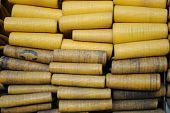 image of firehose  - Many folded yellow firehoses tightly packed together - JPG
