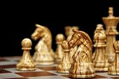 pic of chessboard  - closeup of chess pieces on chessboard on black background - JPG