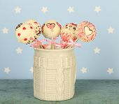 stock photo of cake pop  - Tasty cake pops on blue background - JPG