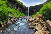 stock photo of water jet  - Picturesque waterfall Svartifoss in Skaftafell National Park of Iceland - JPG