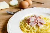 foto of carbonara  - spaghetti carbonara on wooden table with ingredient - JPG