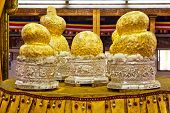 stock photo of shan  - Sacred gilded Buddha images at Phaung Daw Oo pagoda - JPG