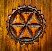 stock photo of carving  - traditional folk art carved pattern on wood - JPG