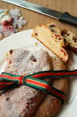 pic of cardamom  - Sliced Christmas stollen the traditional german fruit cake made of bread - JPG