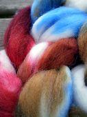 stock photo of alpaca  - Alpaca wool and mohair wool on a wooden board - JPG