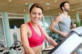 stock photo of cardio  - Woman in fitness club using cardio equipment - JPG