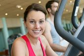picture of cardio  - Woman in fitness club using cardio equipment - JPG