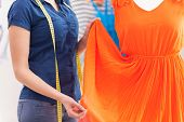 picture of dress mannequin  - Cropped image of woman measuring dress on the mannequin - JPG