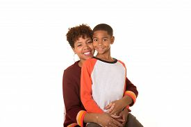 foto of tween  - Mother and tween son isolated on a white background - JPG