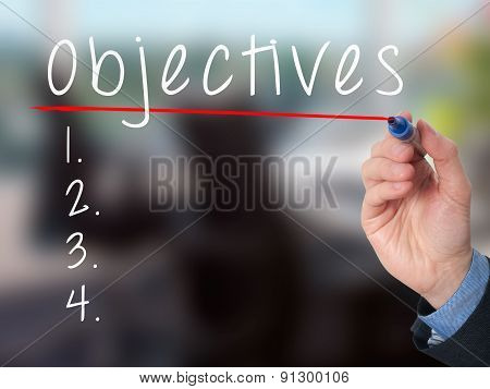 Man Hand writing Objectives to do list with marker.