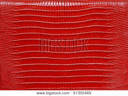 Texture of genuine leather red background close-up