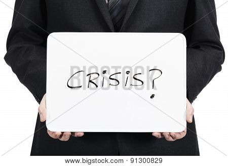 Businessman holding whiteboard with the word Crisis