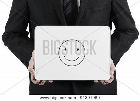 Businessman holding whiteboard with sketched happy face